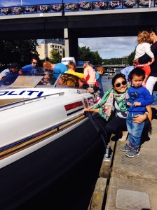 Cousins Nina and Ludvik by the Police boat